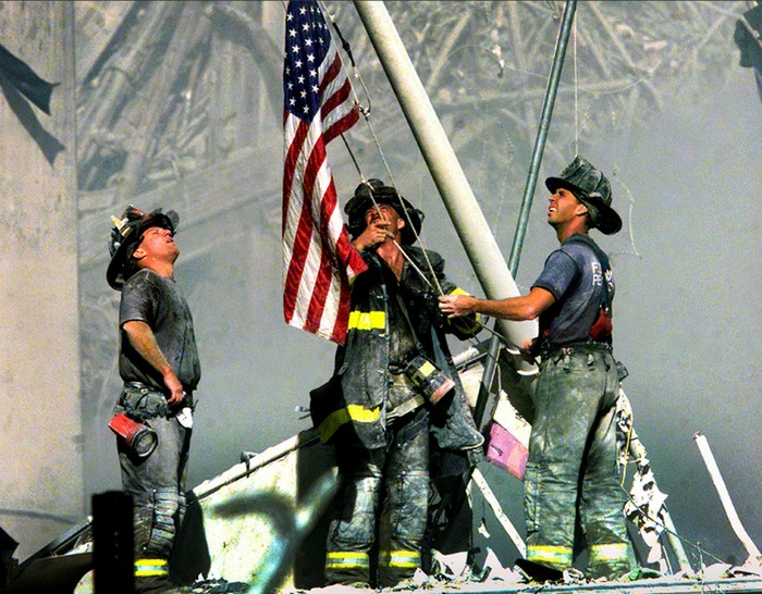 Firefighters raise the American flag on the ruins on the World Trade Centers [2001] Source: Thomas Franklin