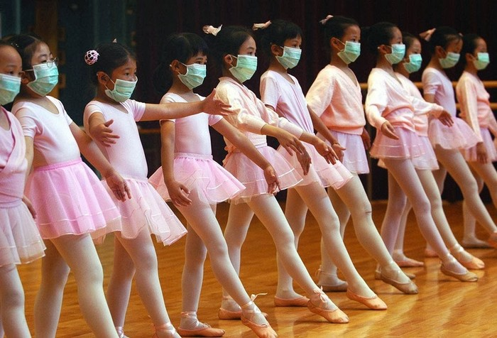 Ballerinas practice with medical masks during the SARS outbreak. [2003]