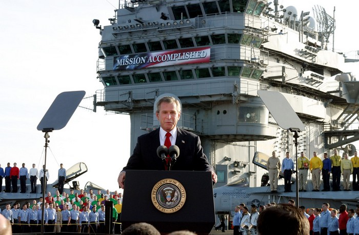 "President Bush addresses sailors in the famous ""Mission Accomplished"" speech, declaring the end of major combat in Iraq. [2003] Source: Unknown Photographer"
