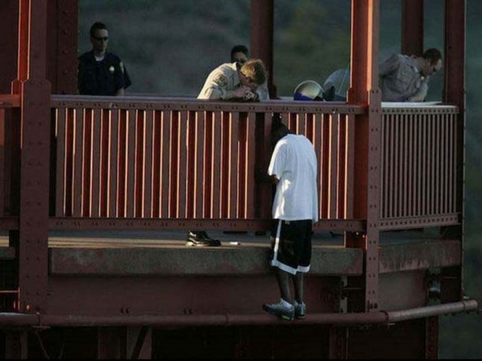 Kevin Berthia is talked out of jumping off the Golden Gate Bridge by police officers. He has since become an advocate for suicide prevention and has started a family. [2005] Source: John Storey / San Francisco Chronicle