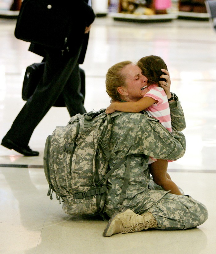 Terri Gurrola is reunited with her daughter after serving in Iraq for 7 months. [2007] Source: BuzzFeed