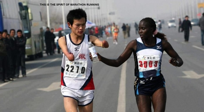 Elite runner Jaqueline Kiplimo helps a disabled Chinese athlete drink during the 2010 Zheng-Kai marathon. She stayed with him for several miles, costing her the 1st place finish and the $10000 prize. [2010]