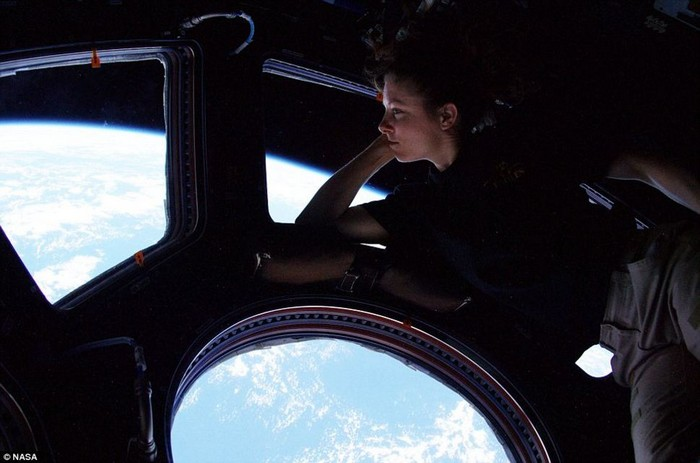 Tracy Caldwell looks down on Earth from the International Space Station [2010] Source: NASA