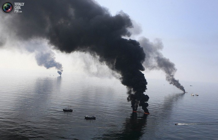 Smoke billows from a controlled burn of spilled oil off the Louisiana coast in the Gulf of Mexico coast line. [2010]