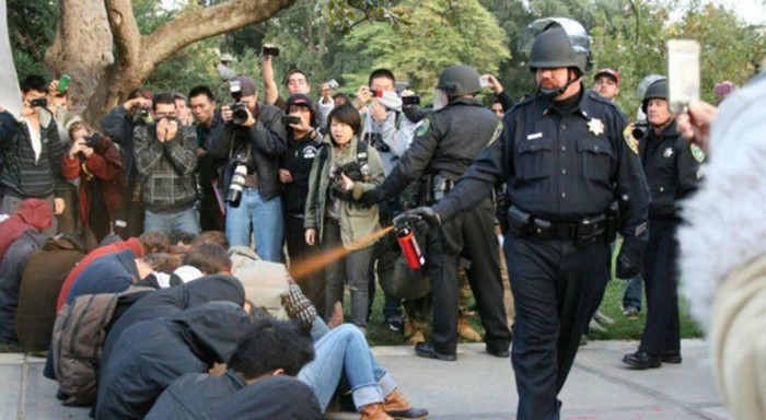 A police officer pepper-sprays Occupy protesters at the University of California [2011] Source: Unknown Photographer