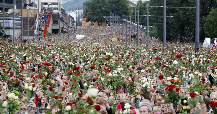 Norwegian citizens hold a flower march after terrorist attacks by Anders Breivik killed 77. [2011] Source: Unknown Photographer