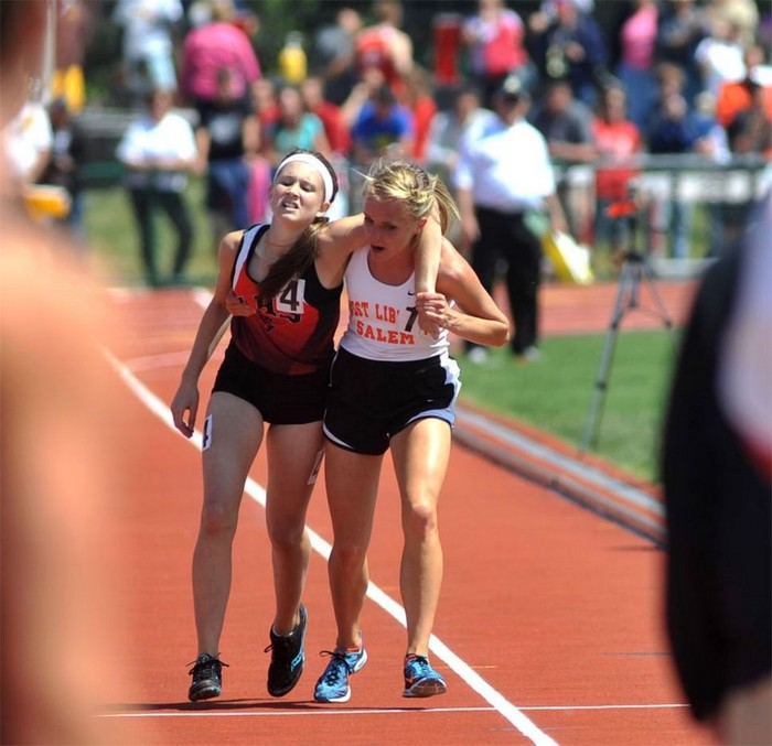 Meghan Vogel, a high school runner, helps her exhausted rival cross the finish line. [2012] Source: AP