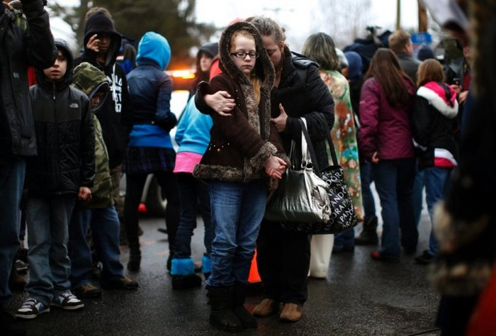 A mother comforts her daughter after the Sandy Hook shootings [2012] Source: Reuters