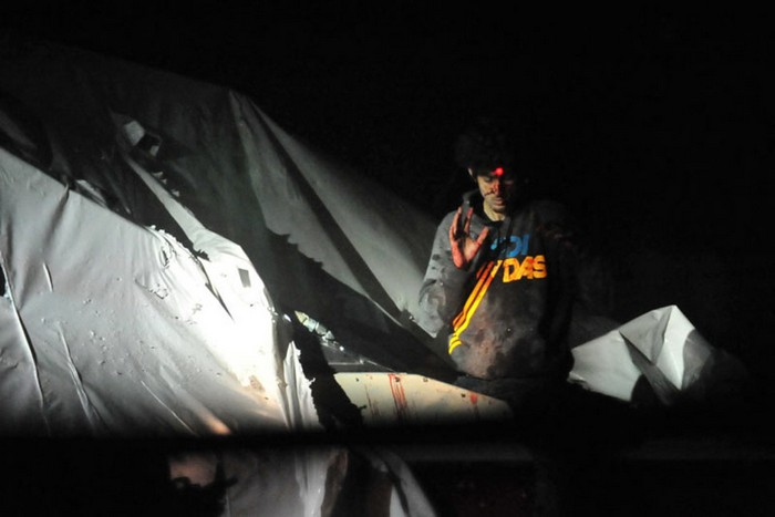 Dzhokar Tsarnaev, one of the brothers behind the Boston Marathon bombing, on the boat where he was eventually caught, with sniper lasers on his forehead. [2013] Source: Unknown Photographer