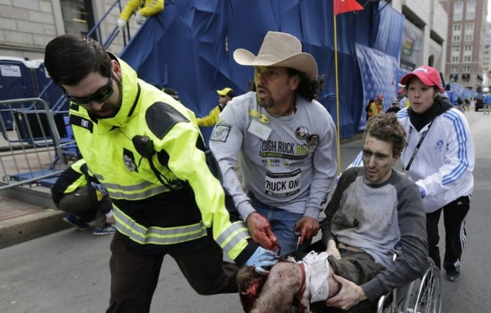 Carlos Arredondo helps Jeff Bauman after the Boston Marathon bombings. The two are now best friends. [2013] Source: AP