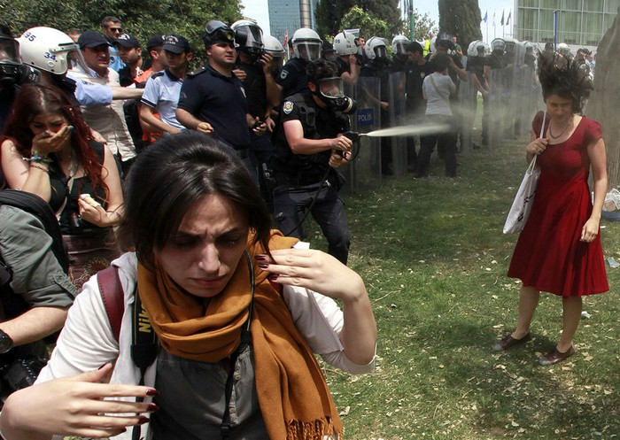 A woman is peper-sprayed at Turkey's Gezi Park protest. [2013] Source: Reuters